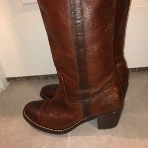 Tall Frye leather boots.